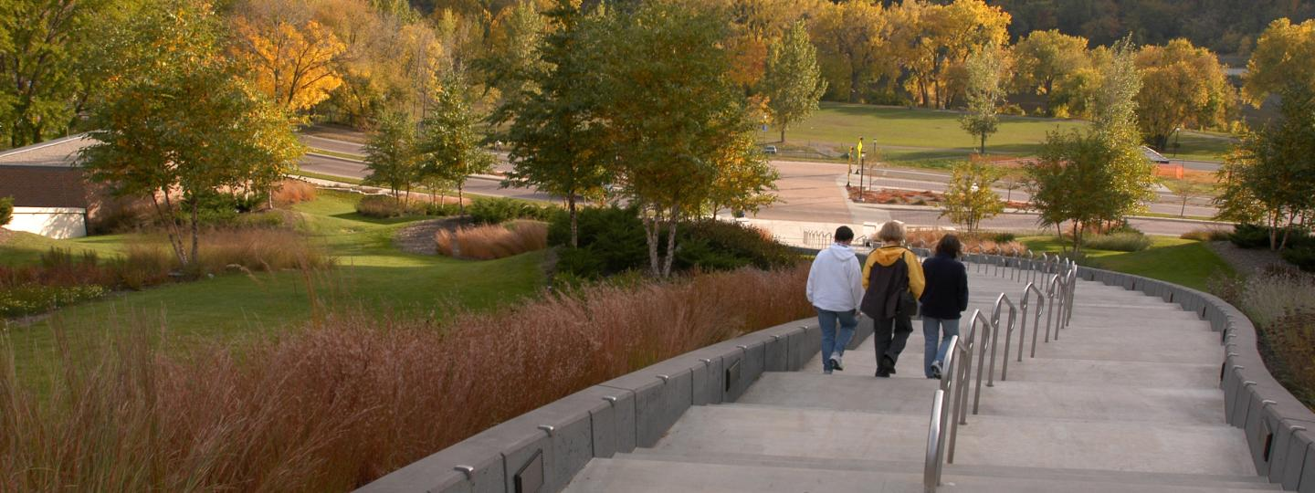 Students take the steps behind Coffman Student Union down toward the Mississippi River