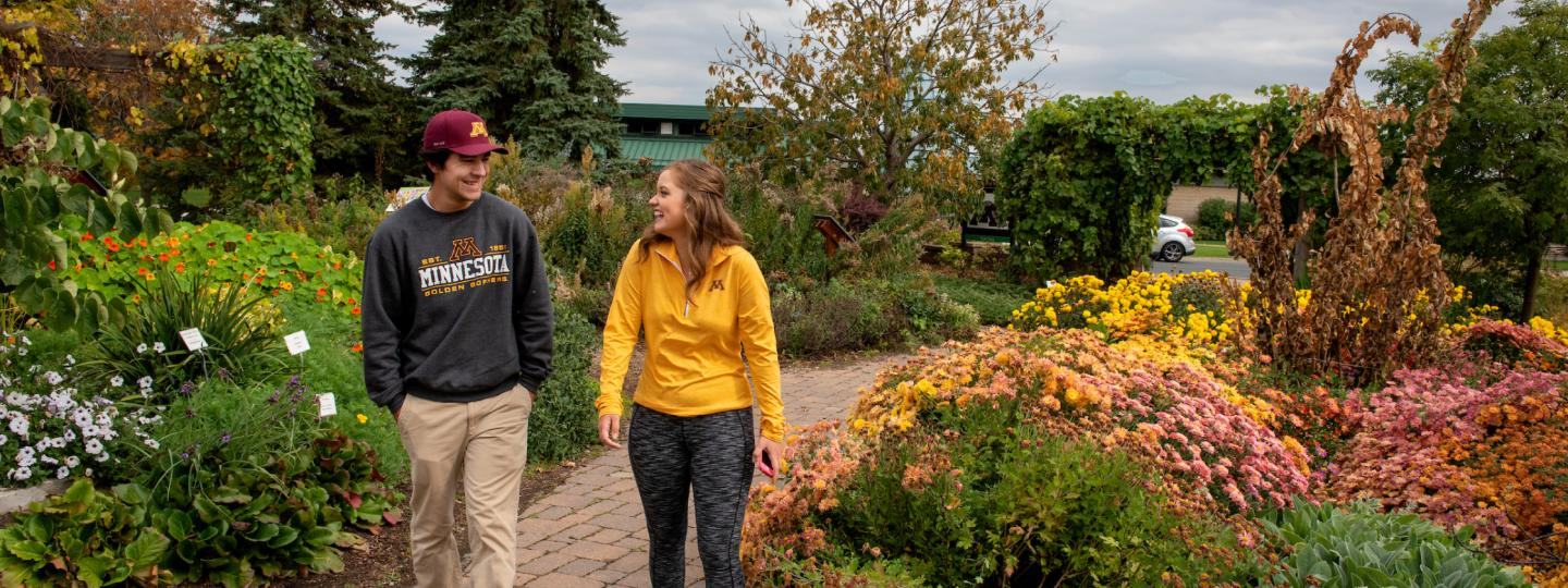 Two students walk through St. Paul campus' Display and Trial Garden