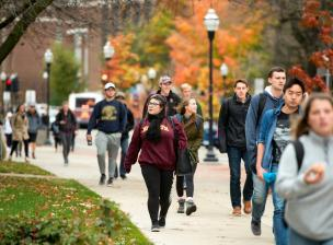 Students walking to class on a fall day.
