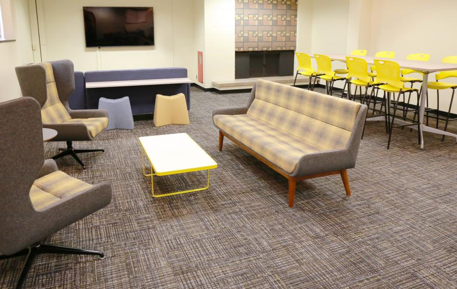 Territorial Hall rec room with a variety of new seating